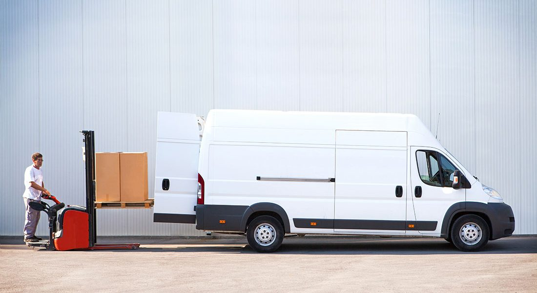 Courier is loading the van with parcels; Shutterstock ID 661996507; Purchase Order: -